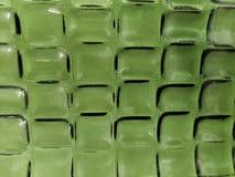 el acercamiento al vidrio adentro ggreen color con diseño geométrico, el fondo y la textura imagenes de archivo