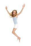 El adolescente bonito salta y las manos para arriba Fotografía de archivo libre de regalías