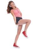 El adolescente bonito se divierte el bailar a la música Fotografía de archivo