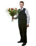 El adolescente con las flores Imagen de archivo
