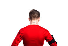 El adolescente con los auriculares, en rojo se divierte la camiseta Aislado Fotos de archivo libres de regalías