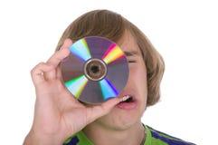 El adolescente con un disco óptico Foto de archivo