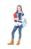 El adolescente de la muchacha se coloca con los libros Imagen de archivo
