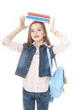 El adolescente de la muchacha se coloca con los libros Fotografía de archivo