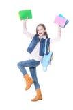 El adolescente de la muchacha se coloca con los libros Imagenes de archivo