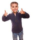 El adolescente del bebé aumentó sus pulgares para arriba aislados Imagenes de archivo
