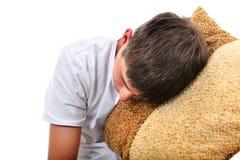 El adolescente duerme con el amortiguador Fotos de archivo libres de regalías