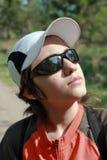 El adolescente en gafas de sol Foto de archivo libre de regalías