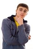 El adolescente en la chaqueta azul está empollando Fotografía de archivo libre de regalías