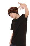 El adolescente en un chaleco negro y un sombrero Imágenes de archivo libres de regalías