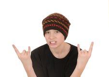 El adolescente en un chaleco negro y un sombrero Foto de archivo libre de regalías