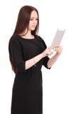 El adolescente feliz del estudiante guarda la PC de la tableta el colocarse de lado Imagen de archivo
