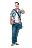 El adolescente feliz muestra los pulgares para arriba Fotografía de archivo libre de regalías