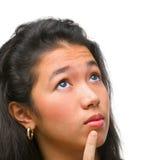El adolescente femenino está pensando Imágenes de archivo libres de regalías