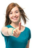 El adolescente femenino muestra los pulgares para arriba Foto de archivo