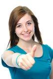 El adolescente femenino muestra los pulgares para arriba Imagenes de archivo