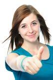 El adolescente femenino muestra los pulgares para arriba Imágenes de archivo libres de regalías