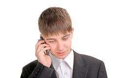 El adolescente habla en el teléfono Fotografía de archivo libre de regalías