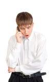 El adolescente habla en el teléfono Fotos de archivo libres de regalías