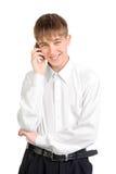 El adolescente habla en el teléfono Foto de archivo