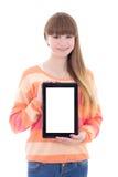El adolescente hermoso que sostiene la tableta con el copyspace es Foto de archivo libre de regalías