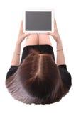 El adolescente lleva a cabo la opinión de la tableta desde arriba Fotografía de archivo