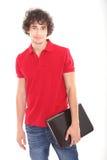 El adolescente masculino con la computadora portátil - copie el espacio Fotografía de archivo libre de regalías