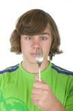 El adolescente mira un enchufe Foto de archivo libre de regalías