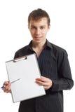 El adolescente muestra una carpeta Foto de archivo libre de regalías