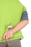 El adolescente oculta la cuchara Imagenes de archivo