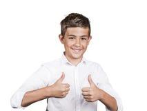 El adolescente que da los pulgares sube gesto Fotos de archivo
