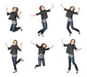 El adolescente que salta en el fondo blanco Imagen de archivo libre de regalías