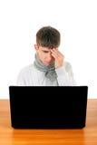El adolescente siente dolor de cabeza Imagenes de archivo