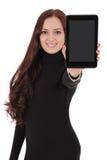 El adolescente sonriente del estudiante que muestra una tableta exhibe applicatio Imagen de archivo libre de regalías