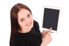 El adolescente sonriente del estudiante que muestra una tableta exhibe applicatio Foto de archivo libre de regalías