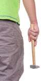 El adolescente sostiene un martillo Imagen de archivo