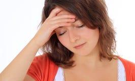 El adolescente sufre de dolor de cabeza Foto de archivo