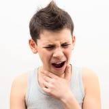 El adolescente sufre dolor Imagen de archivo