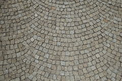El adoquín empiedra la calle que pavimenta el fondo redondeado Fotos de archivo libres de regalías