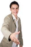 El adulto joven sacude las manos Imágenes de archivo libres de regalías