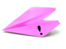 El aeroplano de papel trae una idea Fotos de archivo