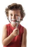 El afeitar adorable del niño Foto de archivo libre de regalías