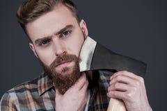 El afeitar con el hacha Fotografía de archivo