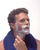 El afeitar del hombre joven Fotografía de archivo libre de regalías