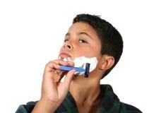 El afeitar joven del muchacho imagen de archivo libre de regalías