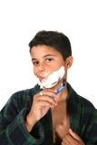 El afeitar joven del muchacho Foto de archivo libre de regalías
