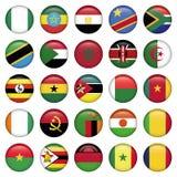 El africano señala por medio de una bandera alrededor de iconos Fotografía de archivo