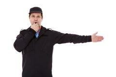 El agente de seguridad dirige tráfico Imagenes de archivo