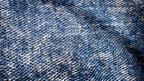 El agitar azul texturizado tela del dril de algodón Movimiento animado de la lona Animación del fondo de los vaqueros que agita e imagenes de archivo