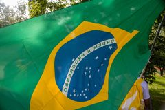 El agitar brasileño de la bandera taked por una persona fotos de archivo libres de regalías